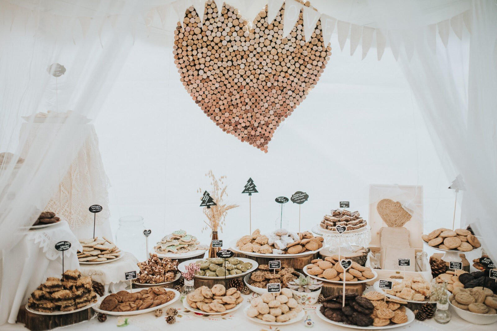 Beautiful cookie table with cork heart.